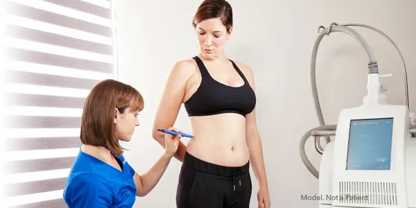 Doctor prepping patient for CoolSculpting treatment